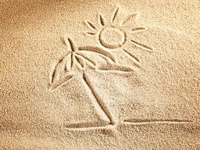 dessin de vacances inscris dans le sable